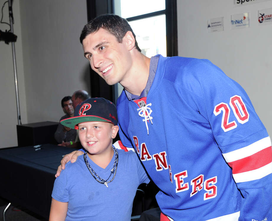 At right, Chris Kreider of the New York Rangers poses for a photo with fan Nick Champagne, 9, of Westchester, N.Y., during the Cam Atkinson Keep Hope Alive Festival to benefit the Marty Lyons Foundation at Old Town Hall in Stamford, Friday night, July 26, 2013. Photo: Bob Luckey / Greenwich Time