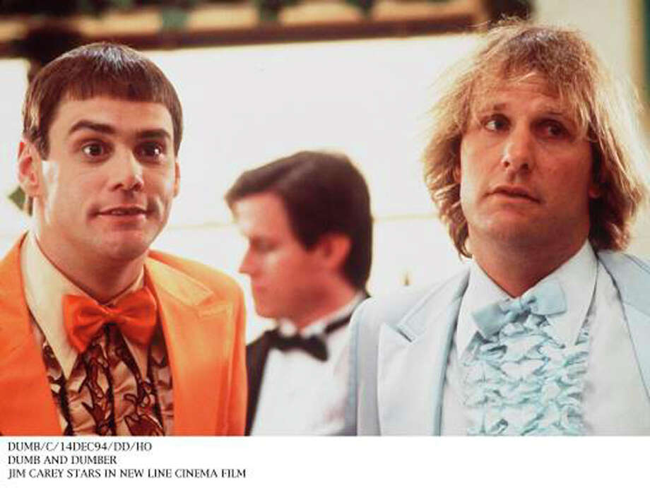 Dumb and Dumber: If there are two people you really don't want to drive with from Providence, R.I., to Aspen, Colo., or anywhere, they're probably  the brainless pals played by Jim Carrey (left) and Jeff Daniels in Peter Farrelly's comedy. Sample line: 'According to the map, we've only gone four inches.' Photo: New Line Cinema, 1994