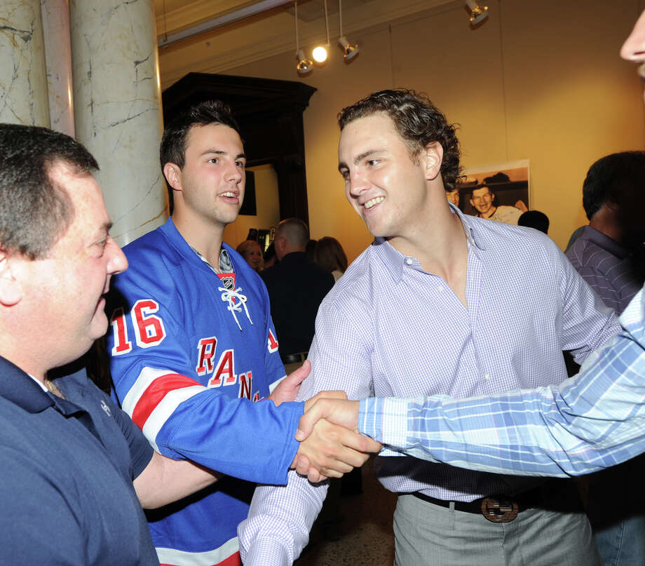 At left, Derick Brassard of the New York Rangers and Kevin Shattenkirk of the St. Louis Blues during the Cam Atkinson Keep Hope Alive Festival to benefit the Marty Lyons Foundation at Old Town Hall in Stamford, Friday night, July 26, 2013. Photo: Bob Luckey / Greenwich Time