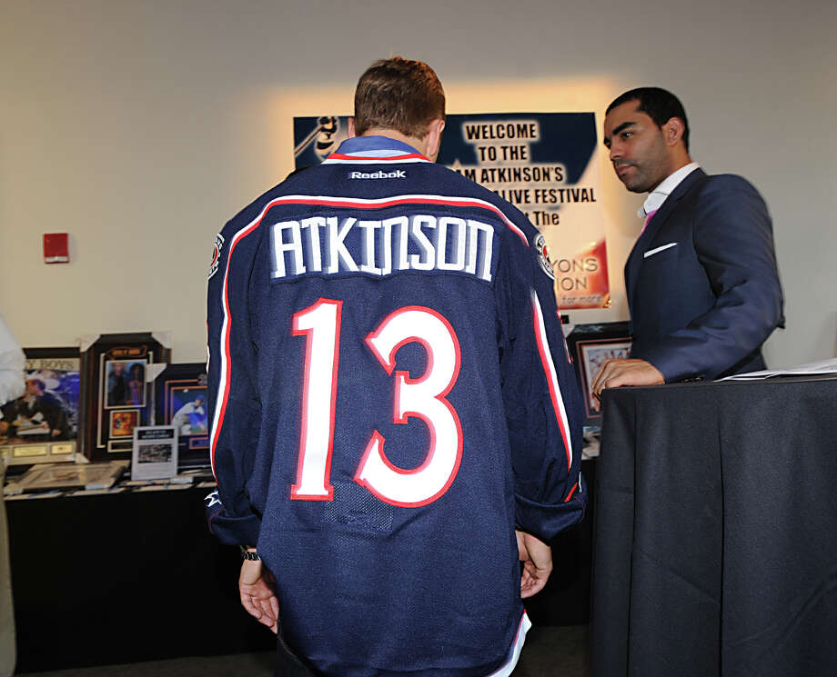 Greenwich native Cam Atkinson, of the NHL's Columbus Blue Jackets(# 13), during his benefit, the Cam Atkinson Keep Hope Alive Festival to benefit the Marty Lyons Foundation at Old Town Hall in Stamford, Friday night, July 26, 2013. The Marty Lyons FoundationâÄôs mission is granting wishes to children with terminally ill and life threatening illnesses. Photo: Bob Luckey / Greenwich Time