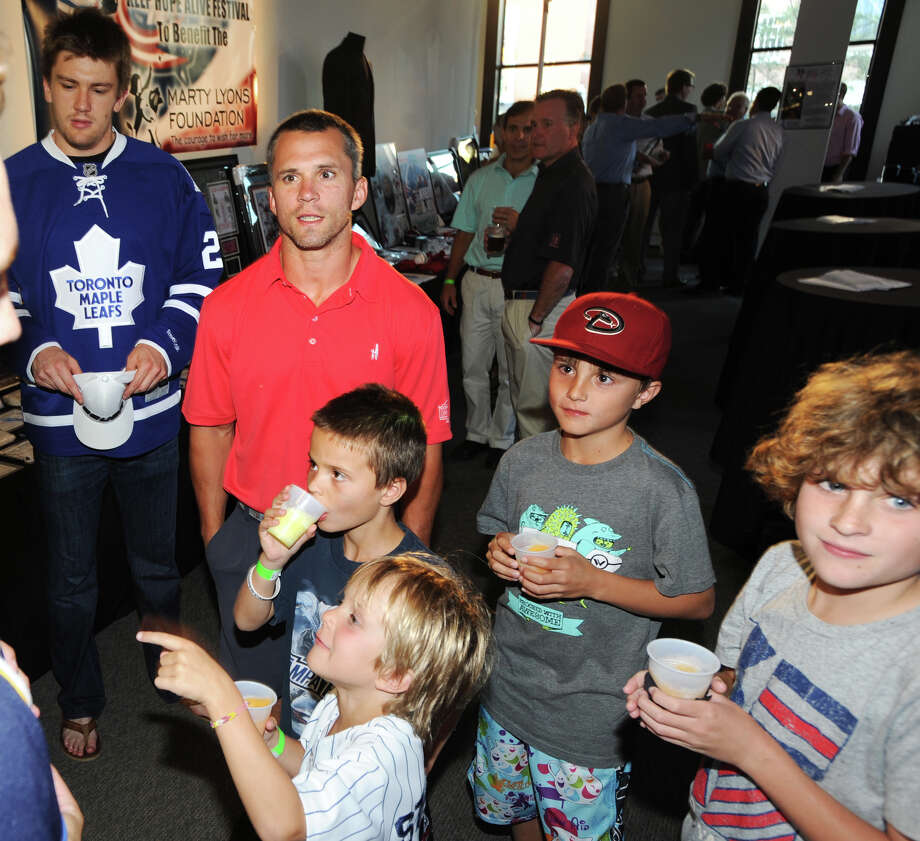The NHL's Tampa Bay Lightning star, Martin St. Louis, second from left, during the Cam Atkinson Keep Hope Alive Festival to benefit the Marty Lyons Foundation at Old Town Hall in Stamford, Friday night, July 26, 2013. Photo: Bob Luckey / Greenwich Time