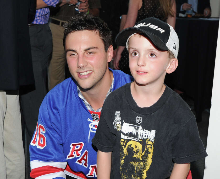 At left, Derick Brassard of the New York Rangers with John Welch, 6, of Norwalk, during the Cam Atkinson Keep Hope Alive Festival to benefit the Marty Lyons Foundation at Old Town Hall in Stamford, Friday night, July 26, 2013. Photo: Bob Luckey / Greenwich Time