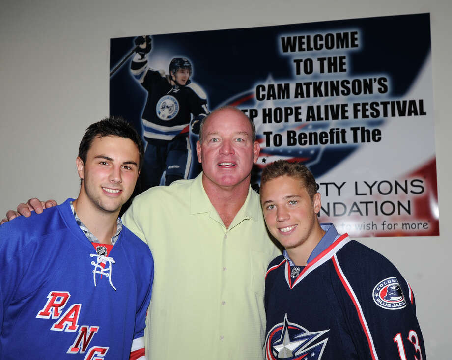 At center, former N.Y. Jet football star Marty Lyons with New York Ranger Derick Brassard, left, and Greenwich native Cam Atkinson, right, of the Columbus Blue Jackets, during the Cam Atkinson Keep Hope Alive Festival to benefit the Marty Lyons Foundation at Old Town Hall in Stamford, Friday night, July 26, 2013. The Marty Lyons FoundationâÄôs mission is granting wishes to children with terminally ill and life threatening illnesses Photo: Bob Luckey / Greenwich Time