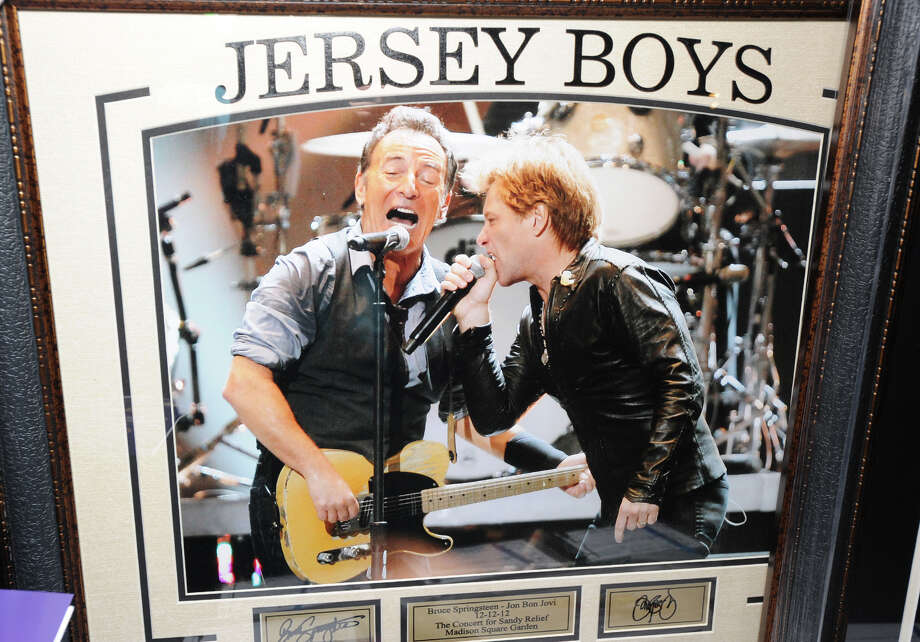 "A Bruce Springsteen (left) and Jon Bon Jovi photograph, ""Jersey Boys,"" was one of the items auctioned during the Cam Atkinson Keep Hope Alive Festival to benefit the Marty Lyons Foundation at Old Town Hall in Stamford, Friday night, July 26, 2013. Photo: Bob Luckey / Greenwich Time"