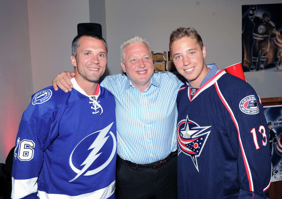 Tom Atkinson of Greenwich, center, puts his arm around his son, Greenwich native, Cam Atkinson, right, of the NHL's Columbus Blue Jackets, and Tampa Bay Lightning star, Martin St. Louis, also of Greenwich, during the Cam Atkinson Keep Hope Alive Festival to benefit the Marty Lyons Foundation at Old Town Hall in Stamford, Friday night, July 26, 2013. The Marty Lyons FoundationâÄôs mission is granting wishes to children with terminally ill and life threatening illnesses. Photo: Bob Luckey / Greenwich Time
