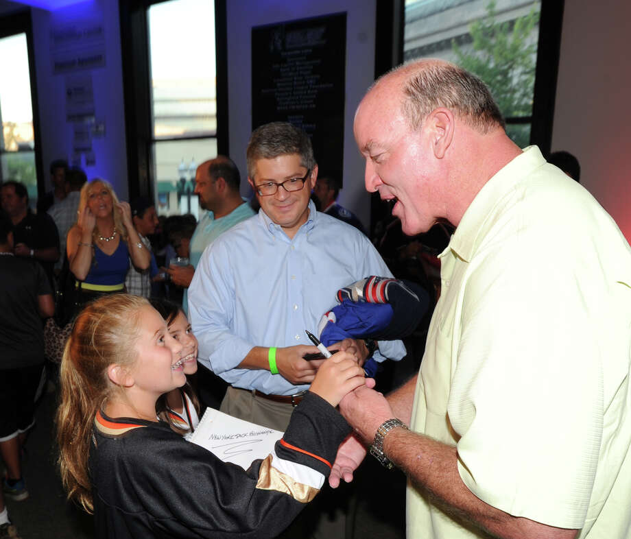 At right, former N.Y. Jet football star Marty Lyons speaks with Greenwich sisters, Molly Braun, 10, at left, and M.K. Braun, 9, during the Cam Atkinson, center, of the Columbus Blue Jackets, smiles during the Cam Atkinson Keep Hope Alive Festival to benefit the Marty Lyons Foundation at Old Town Hall in Stamford, Friday night, July 26, 2013. The Marty Lyons FoundationâÄôs mission is granting wishes to children with terminally ill and life threatening illnesses Photo: Bob Luckey / Greenwich Time