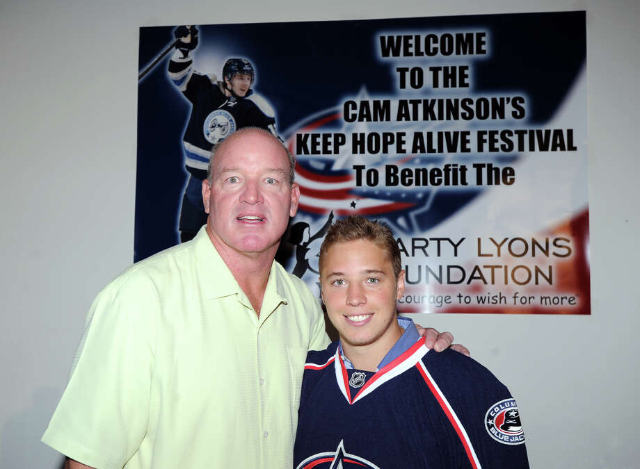 At left, former N.Y. Jet football star, Marty Lyons, with Greenwich native, Cam Atkinson, center, of the NHL's Columbus Blue Jackets, during Atkinson's Keep Hope Alive Festival to benefit the Marty Lyons Foundation at Old Town Hall in Stamford, Friday night, July 26, 2013. The Marty Lyons FoundationâÄôs mission is granting wishes to children with terminally ill and life threatening illnesses Photo: Bob Luckey / Greenwich Time