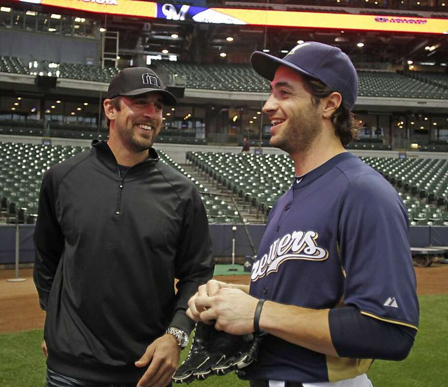 Aaron Rodgers (left) and Ryan Braun are longtime friends and business partners. Photo: Jeffrey Phelps, Associated Press