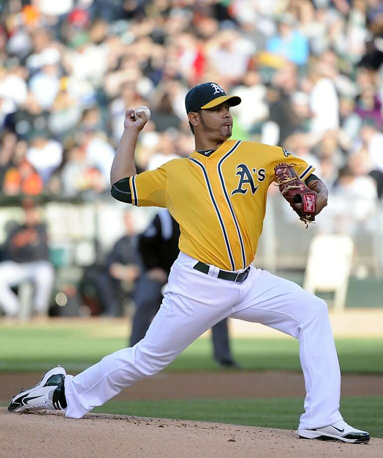 OAKLAND, CA -  JUNE 18: Guillermo Moscoso #52 of the Oakland Athletics pitches in the first inning against the San Francisco Giants during a MLB baseball game June 18, 2011 at the Oakland-Alameda County Coliseum in Oakland, California. Photo: Thearon W. Henderson, Getty Images