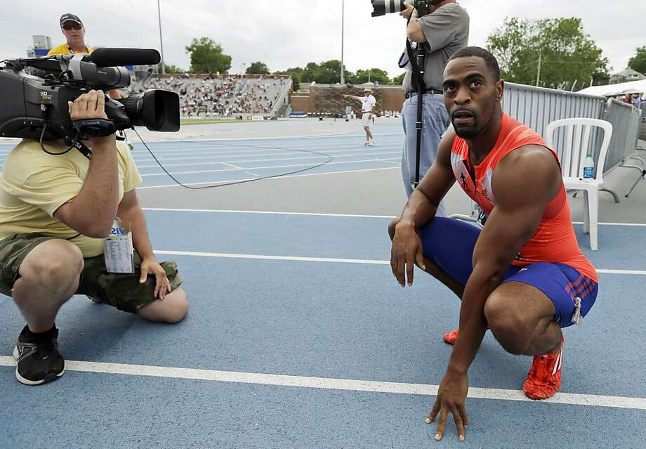 Tyson Gay tested positive at the national championships, where he won the 100 and 200. Photo: Charlie Neibergall, Associated Press