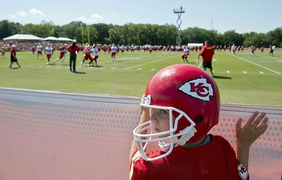 Sean Tenebehn, 8, of Shawnee, Kansas, watches his first Kansas City Chiefs training camp practice while wearing his toy Chiefs helmet at Missouri Western State University in St. Joseph, Missouri, Friday, July 26, 2013. (David Eulitt/Kansas City Star/MCT) Photo: David Eulitt, McClatchy-Tribune News Service