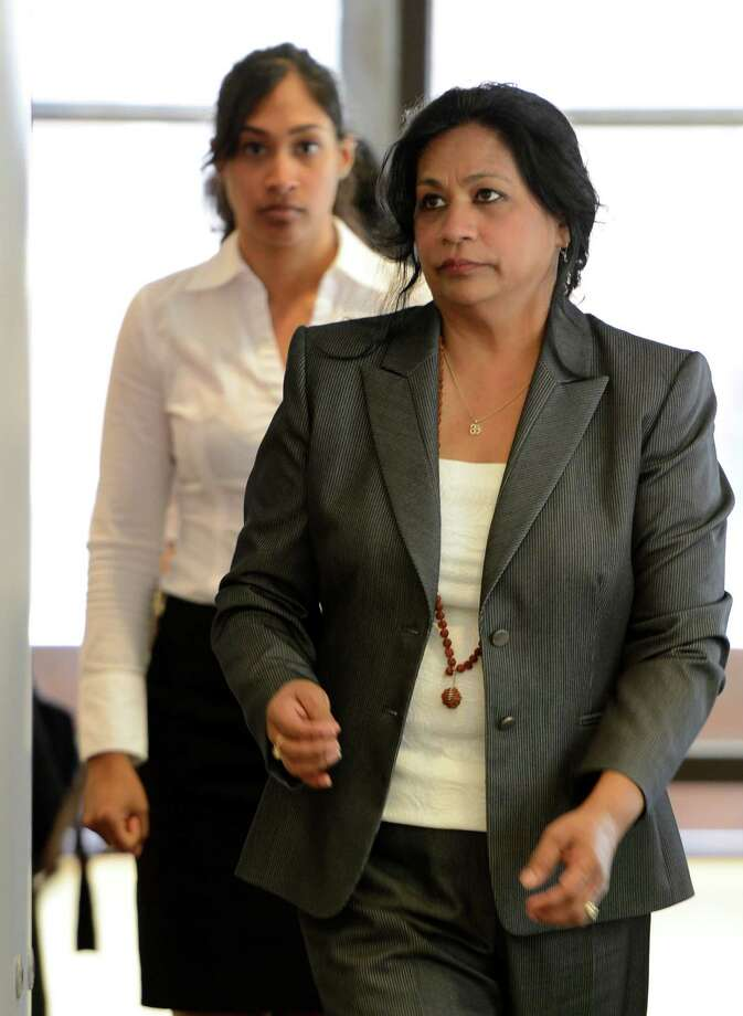 "Mahadaye ""Mala"" Khan, right, followed by her daughter Shereen Khan return from lunch adjournment for the continuation of opening statements Tuesday, July 16, 2013, at the Albany County Judicial Center in Albany, N.Y.  Mala, a city landlord, is charged with labor trafficking for allegedly inducing a fellow immigrant from Trinidad and Tobago into a fake marriage and using that to blackmail him into illegally working for her. She and her daughter are also charged with stealing security deposits from tenants. (Skip Dickstein / Times Union ) Photo: Skip Dickstein / 00023201A"