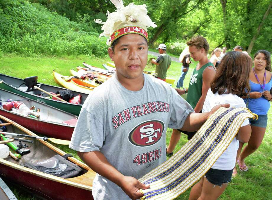 Onondaga head paddler, Hickory Edwards holds the Two Row Wampum belt Saturday July 13, 2013, at the Mabee Farm in Rotterdam Junction, N.Y. Native and non-native paddlers are making the journey to Albany and New York City bringing to life the imagery of the Two Row Wampum belt.  The symbolism represents the ability to live side-by-side in peace and friendship, respecting each others distinct ways of life and sovereignty.  (John Carl D'Annibale / Times Union) Photo: John Carl D'Annibale / 00023037A