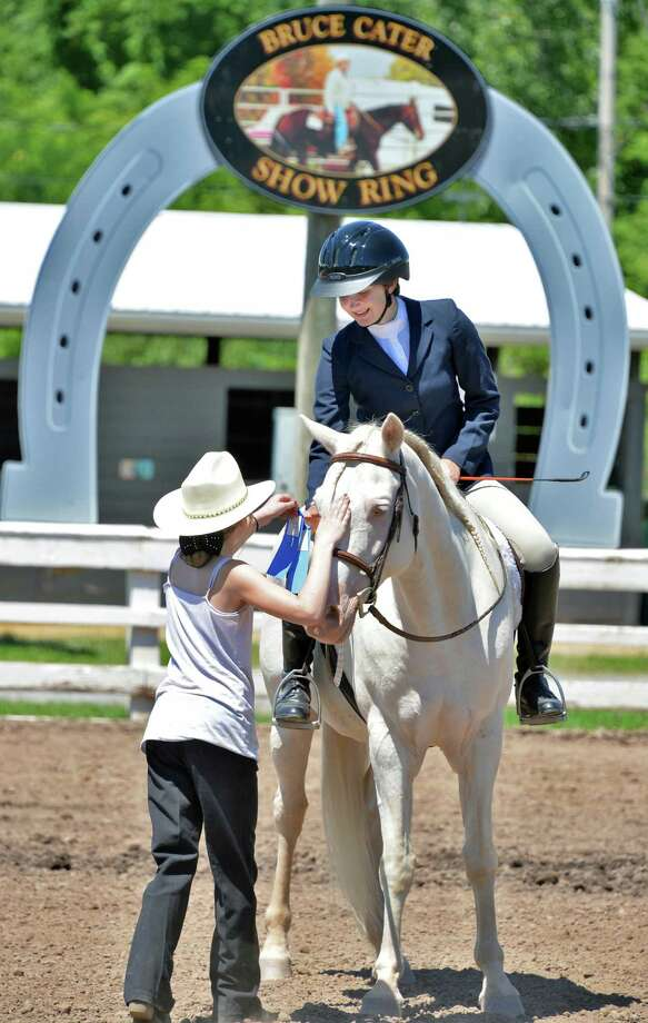 Shannon Vogt, 16, of Cobleskill recieves a blue ribbon in the 4H Youth Horse Show Friday afternoon, July 26, 2013, at the Schoharie County Sunshine Fair in Cobleskill, N.Y.  (John Carl D'Annibale / Times Union) Photo: John Carl D'Annibale / 00023173A