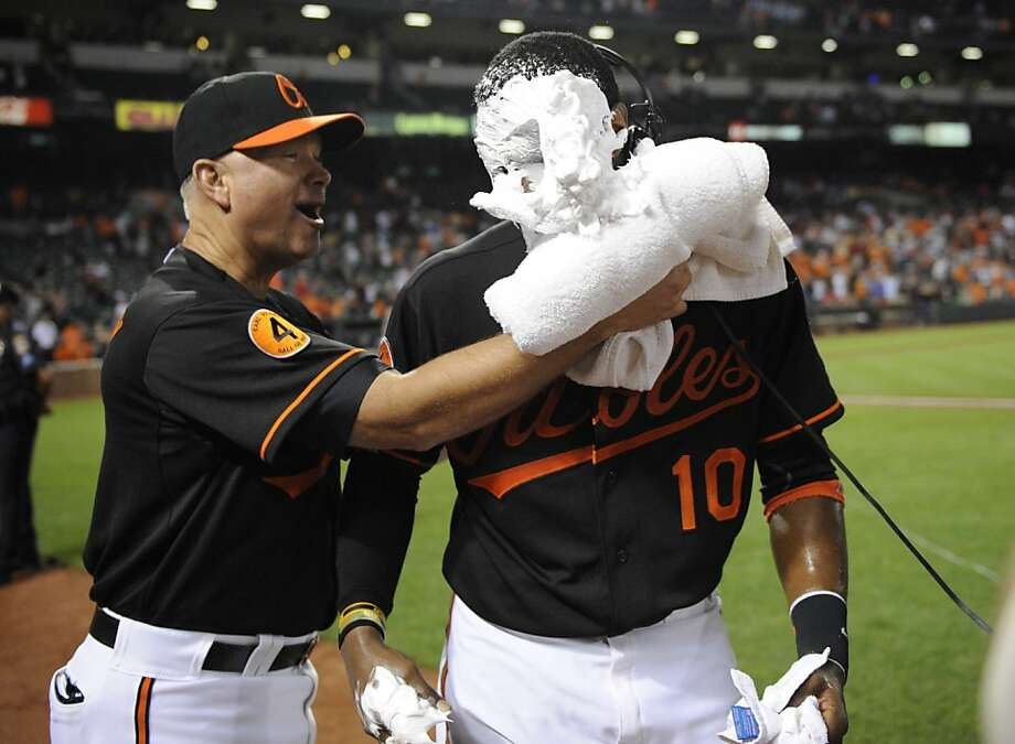 Baltimore Orioles batting coach Jim Presley, left, pies Adam Jones (10) after a 6-0 win over the Boston Red Sox in a baseball game on Friday, July 26, 2013, in Baltimore. (AP Photo/Nick Wass) Photo: Nick Wass, Associated Press