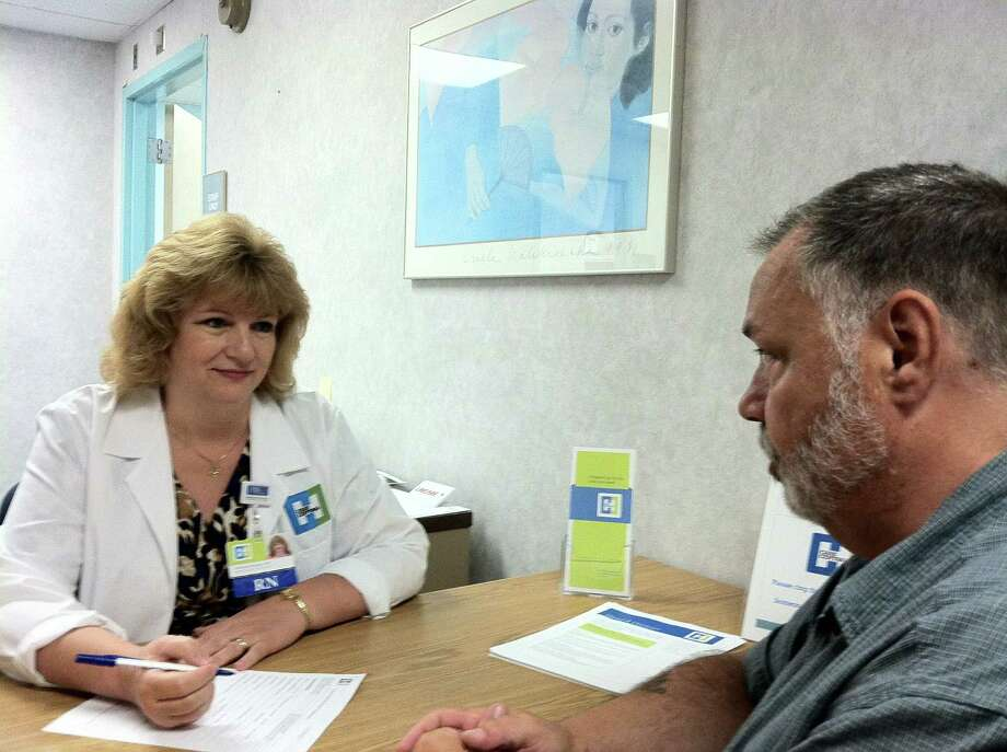 Navigator Faithann Amond assists patient Lewis Benware with accessing services at Ellis Medicine and throughout the community.