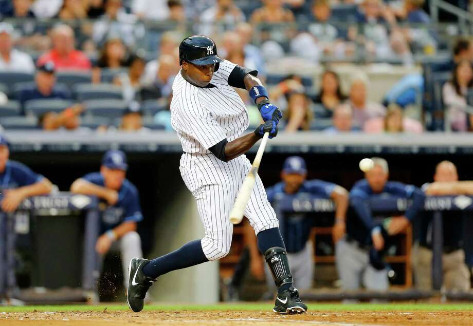NEW YORK, NY - JULY 26:  Alfonso Soriano #12 of the New York Yankees flies out to center field in the second inning against the at Yankee Stadium on July 26, 2013  in the Bronx borough of New York City. Photo: Jim McIsaac, Getty Images / 2013 Getty Images