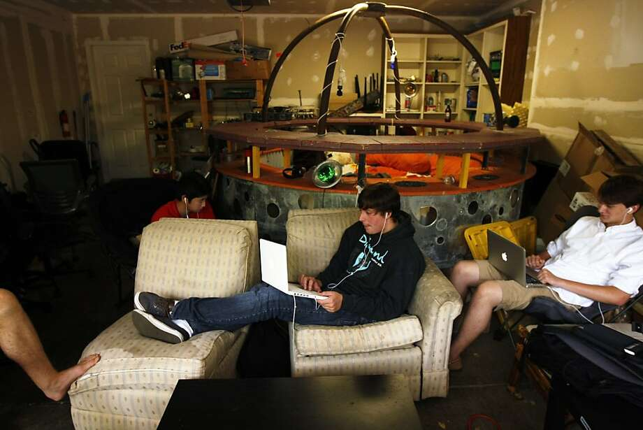 Interns work at the Palo Alto house, above, that serves as headquarters for MakeGamesWithUs. Photo: Rohan Smith, The Chronicle