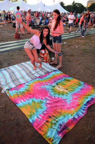 Bronte Uccellini, left, and her freind Jena Wright enjoy the 18th Annual Gathering of the Vibes music festival at Seaside Park in Bridgeport, Conn. on Friday July 27, 2013. Photo: Christian Abraham / Connecticut Post freelance