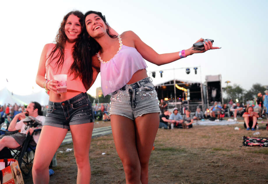 Bronte Uccellini, right, and her freind Jena Wright enjoy the 18th Annual Gathering of the Vibes music festival at Seaside Park in Bridgeport, Conn. on Friday July 27, 2013. Photo: Christian Abraham / Connecticut Post freelance