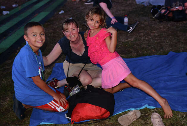 Elizabeth Cicco and her children Josh, 10, and Emily, 6, enjoy the 18th Annual Gathering of the Vibes music festival at Seaside Park in Bridgeport, Conn. on Friday July 27, 2013. Photo: Christian Abraham / Connecticut Post freelance