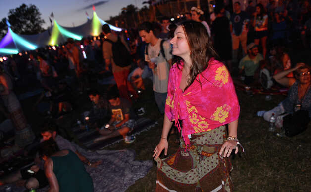 Taylor Laiacona, of Albany, NY, dances during the 18th Annual Gathering of the Vibes music festival at Seaside Park in Bridgeport, Conn. on Thursday July 25, 2013. Photo: Christian Abraham / Connecticut Post freelance