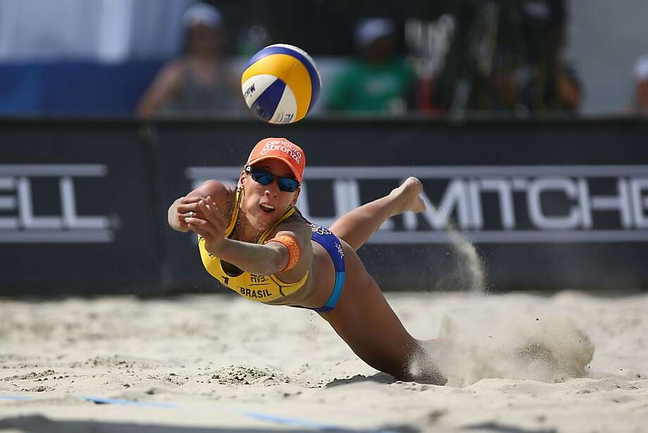 Taiana Lima of Brazil dives for a ball during the women's final match at the ASICS World Series of Beach Volleyball - Day 5 on July 26, 2013 in Long Beach, California.  (Photo by Joe Scarnici/Getty Images) Photo: Joe Scarnici, Getty Images