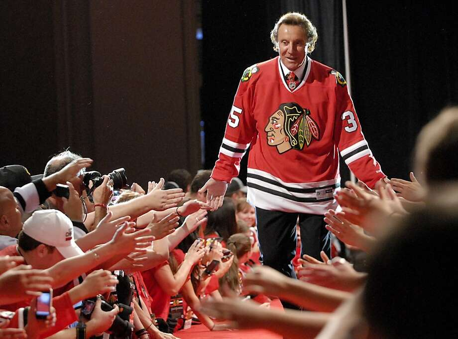 Former Blackhawks goalie Tony Esposito is introduced during the NHL hockey team's sixth annual fan convention, Friday, July 26, 2013, in Chicago. (AP Photo/Daily Herald, Bob Chwedyk) MANDATORY CREDIT  MAGS OUT  TV OUT Photo: Bob Chwedyk, Associated Press