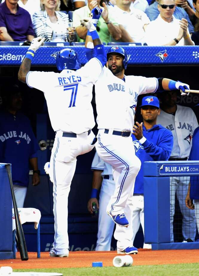 Jose Reyes of the Blue Jays celebrates his solo home run in the third inning. Photo: Jon Blacker, Associated Press/Canadian Press