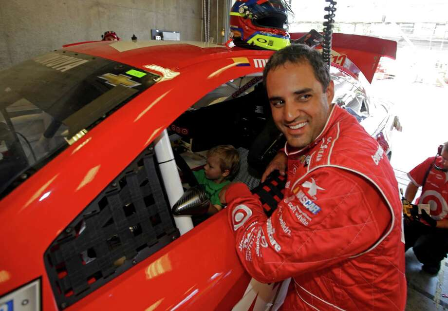 Sprint Cup Series driver Juan Pablo Montoya smiles as he talks with Grissom Golitko, son of NASCAR reporter Raygan Swan, sitting in his car during practice for the Brickyard 400 auto race at the Indianapolis Motor Speedway in Indianapolis, Friday, July 26, 2013. (AP Photo/Darron Cummings) ORG XMIT: NAA117 Photo: Darron Cummings / AP