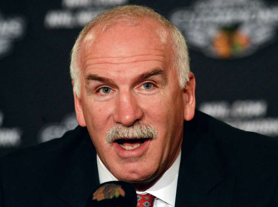 Chicago Blackhawks NHL hockey head coach Joel Quenneville smiles after getting a 3-year contract extension before the sixth annual Blackhawks Convention on Friday, July 26, 2013, in Chicago. Master of Ceremonies and Blackhawks TV Color Analyst Eddie Olczyk hosted  the Opening Ceremonies in the International Ballroom. (AP Photo/Daily Herald, Bob Chwedyk) MANDATORY CREDIT; MAGS OUT. ORG XMIT: ILARL101 Photo: Bob Chwedyk / Daily Herald