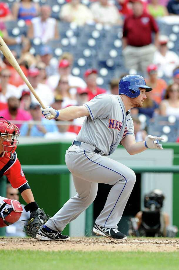 WASHINGTON, DC - JULY 26:  Daniel Murphy #28 of the New York Mets hits a single in the ninth inning against the Washington Nationals at Nationals Park on July 26, 2013 in Washington, DC.  New York won the game 11-0. (Photo by Greg Fiume/Getty Images) ORG XMIT: 171419429 Photo: Greg Fiume / 2013 Getty Images
