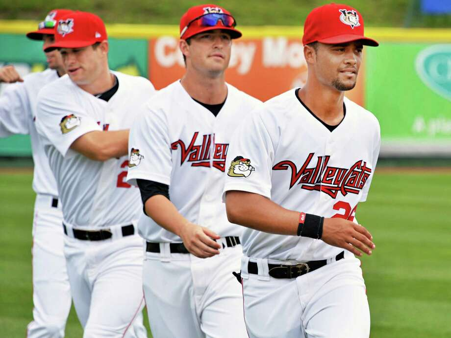 Tri-City ValleyCats outfielder James Ramsay, at right, warms up with teammates before Tuesday's game against Aberdeen at Bruno Stadium in Troy  July 9, 2013.  (John Carl D'Annibale / Times Union) Photo: John Carl D'Annibale / 00023064A