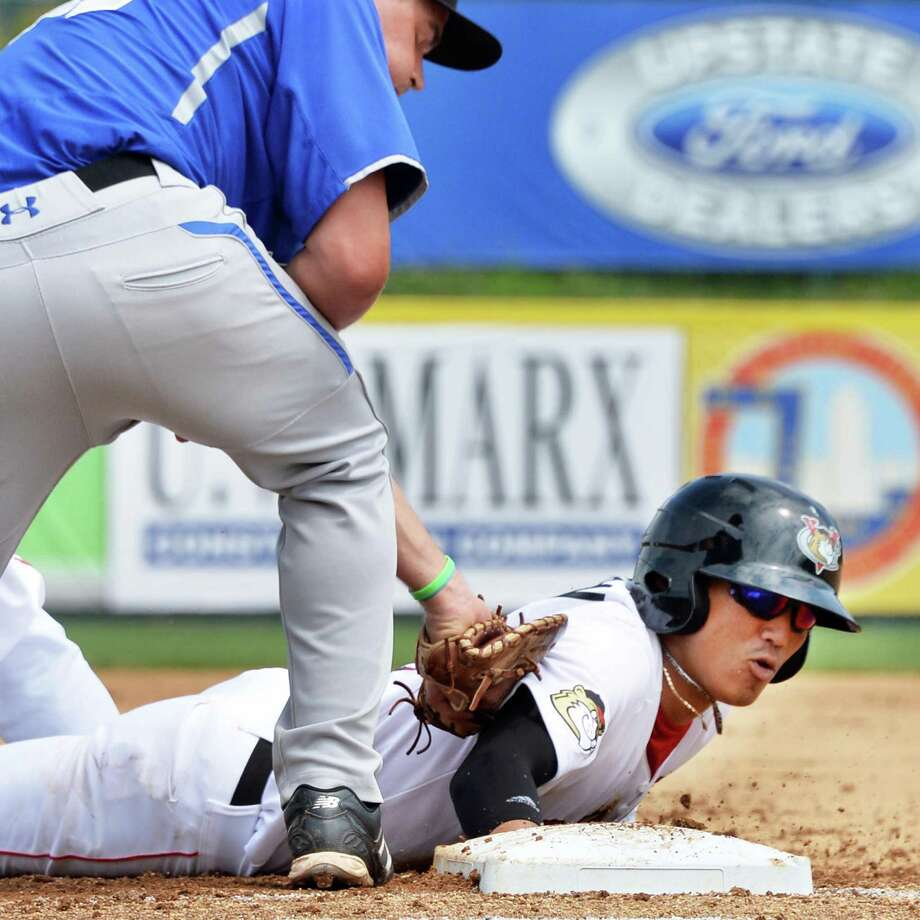 Tri-City ValleyCats' shortstop Chan Moon, at right, makes it back to the bag beating the pick off by Aberdeen's firstbaseman Trey Mancini Tuesday, July 9, 2013, at Bruno Stadium in Troy N.Y.  (John Carl D'Annibale / Times Union) Photo: John Carl D'Annibale / 00023064A