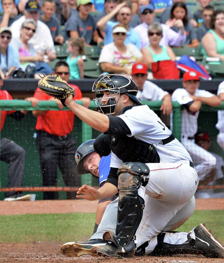 Tri-City ValleyCats catcher Jake Rodriguez looks to the umpire as he puts out Aberdeen's Jeff Kemp at home during Tuesday's game against at Bruno Stadium July 9, 2013, in Troy, N.Y. (John Carl D'Annibale / Times Union) Photo: John Carl D'Annibale / 00023064A