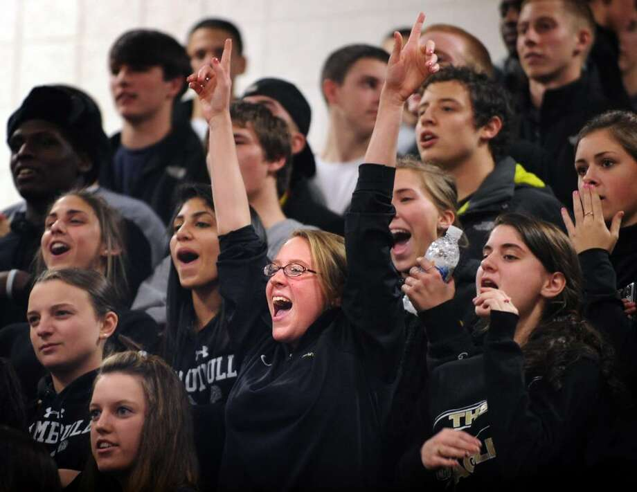 Trumbull fans cheer during Tuesday night's game against St. Joseph. Photo: Autumn Driscoll / Connecticut Post