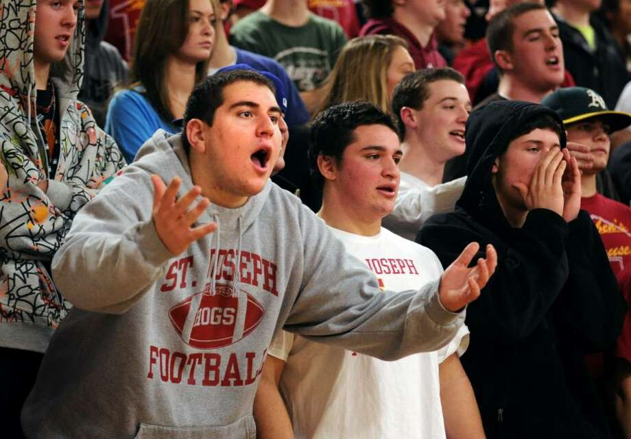 St. Joseph fans react during Tuesday night's game against Trumbull. Photo: Autumn Driscoll / Connecticut Post