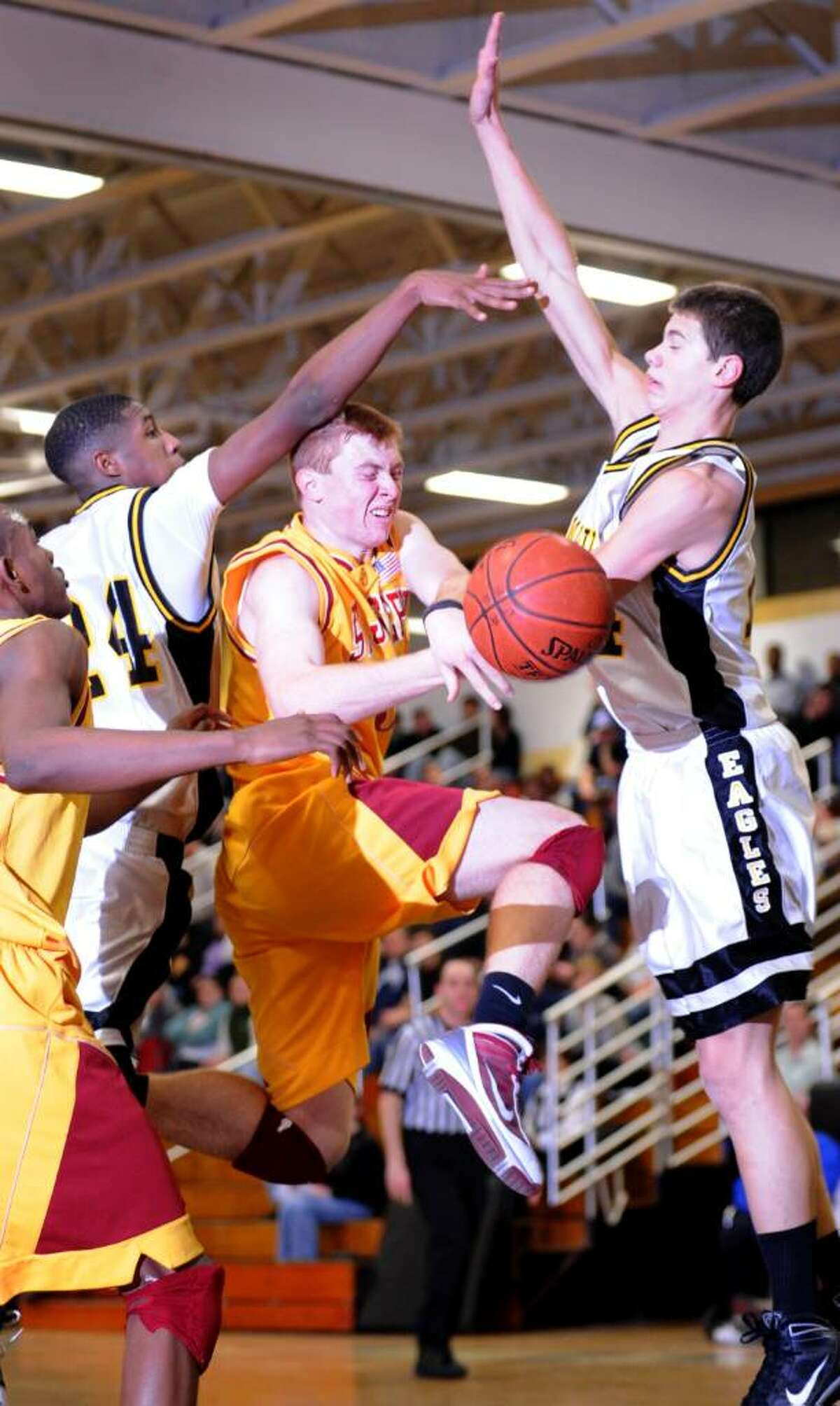 St. Joseph's Brendan Nugent is fouled during Tuesday night's game against Trumbull.