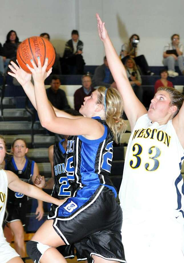 Weston's Dakota Sloop, right, is unable to defend against Bunnell's Erynn Miller during the first period of the girls basketball game at Weston High School on Tuesday, Jan. 19, 2010. Photo: Amy Mortensen / Connecticut Post
