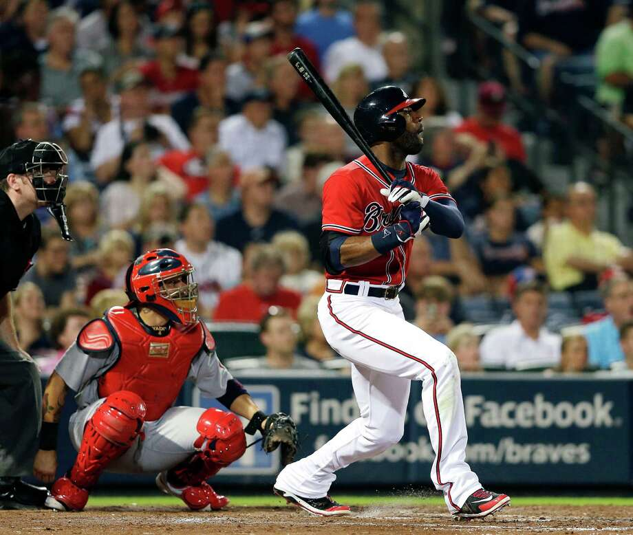 Atlanta Braves' Jason Heyward (22) follows through with a solo home run as St. Louis Cardinals catcher Yadier Molina (4) looks on in the fifth inning of a baseball game, Friday, July 26, 2013, in Atlanta. (AP Photo/John Bazemore) ORG XMIT: GAJB110 Photo: John Bazemore / AP