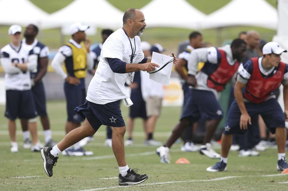 Special teams coach Rich Basaccia works with players during the morning session of the 2013 Dallas Cowboys training camp on Friday, July 26, 2013 in Oxnard. (Kin Man Hui/San Antonio Express-News) Photo: Kin Man Hui, San Antonio Express-News