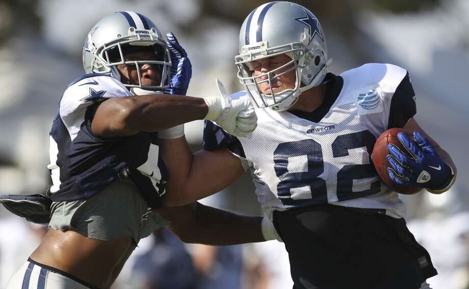 Tight end Jason Witten (82) fights off safety Barry Church (42) during the afternoon session of the 2013 Dallas Cowboys training camp on Friday, July 26, 2013 in Oxnard. (Kin Man Hui/San Antonio Express-News) Photo: Kin Man Hui, San Antonio Express-News