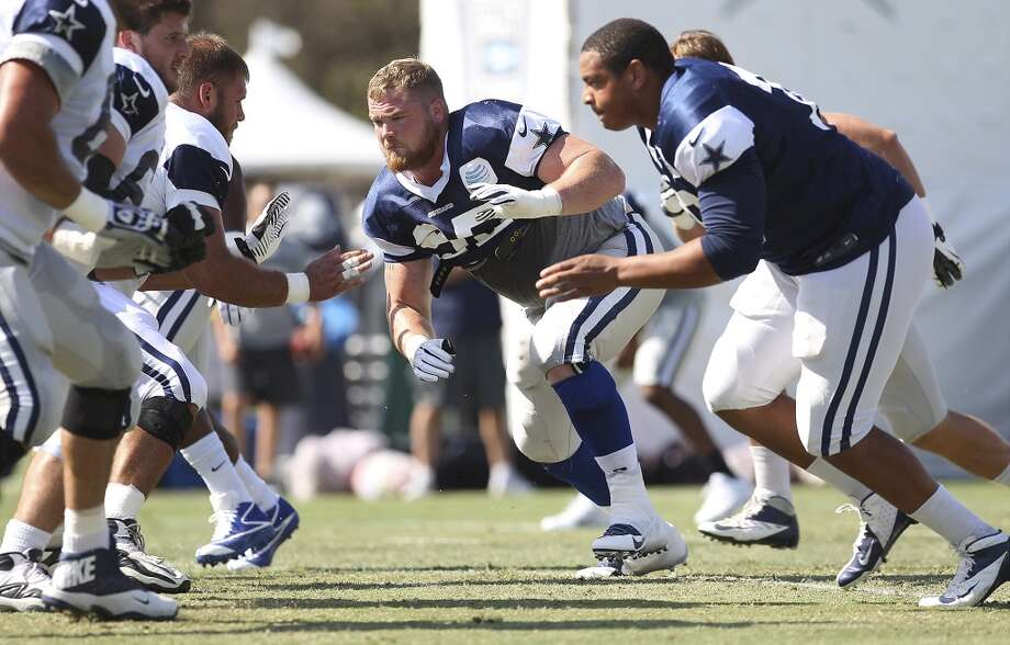 Nose tackle Sean Lissemore (95) joins defensive end Ben Bass (right) in drills during the afternoon session of the 2013 Dallas Cowboys training camp on Friday, July 26, 2013 in Oxnard. (Kin Man Hui/San Antonio Express-News) Photo: Kin Man Hui, San Antonio Express-News