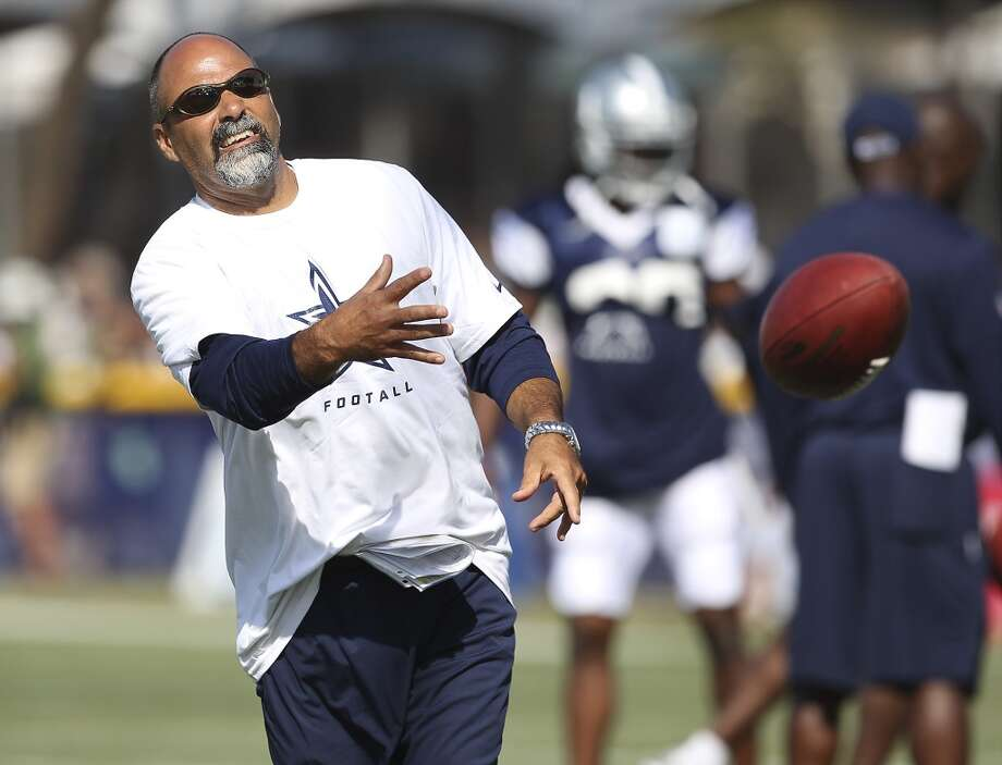 Special teams coach Rich Bisaccia throws the ball to one of his punters during the afternoon session of the 2013 Dallas Cowboys training camp on Friday, July 26, 2013 in Oxnard. (Kin Man Hui/San Antonio Express-News) Photo: Kin Man Hui, San Antonio Express-News