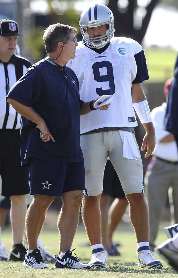Offensive coordinator Bill Callahan (left) goes over a play with quarterback Tony Romo (09) during the afternoon session of the 2013 Dallas Cowboys training camp on Friday, July 26, 2013 in Oxnard. (Kin Man Hui/San Antonio Express-News) Photo: Kin Man Hui, San Antonio Express-News
