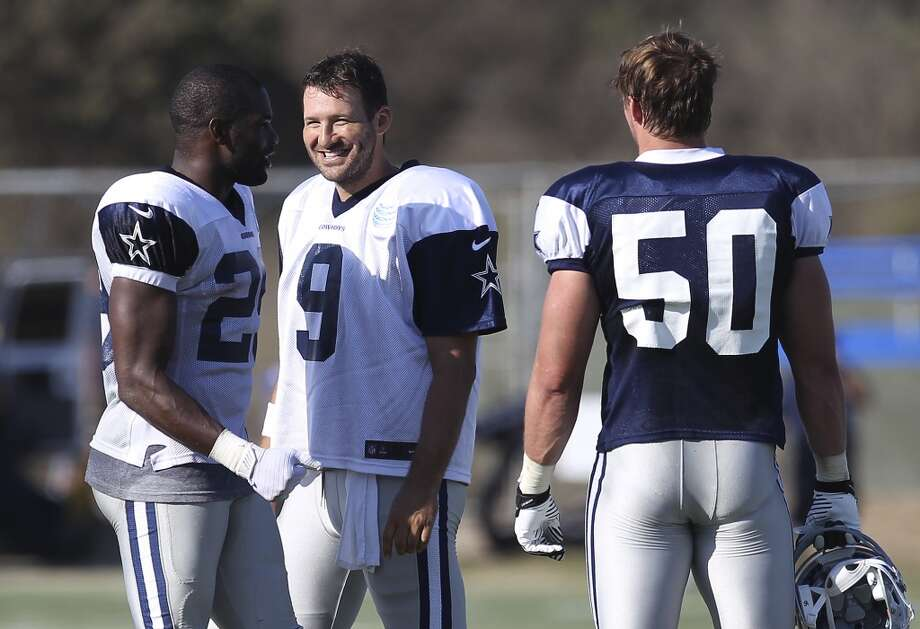 Quarterback Tony Romo (09) smiles while chatting with running back DeMarco Murray (left) and linebacker Sean Lee (50) during the afternoon session of the 2013 Dallas Cowboys training camp on Friday, July 26, 2013 in Oxnard. (Kin Man Hui/San Antonio Express-News) Photo: Kin Man Hui, San Antonio Express-News