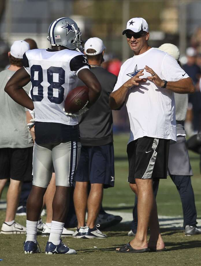 Former Cowboy Jay Novacek (right) talks with receiver Dez Bryant (88) during the afternoon session of the 2013 Dallas Cowboys training camp on Friday, July 26, 2013 in Oxnard. (Kin Man Hui/San Antonio Express-News) Photo: Kin Man Hui, San Antonio Express-News