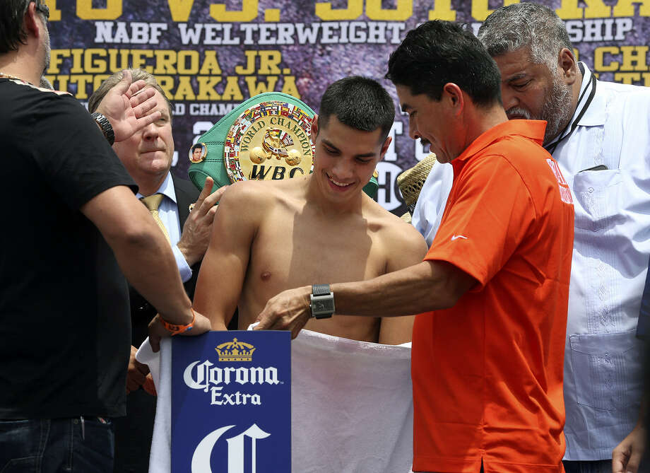 Weslaco's Omar Figueroa Jr. weighs in for his upcoming WBC interim lightweight championship bout against Japan's Nihito Arakawa on Saturday at the AT&T Center. Photo: Tom Reel / San Antonio Express-News