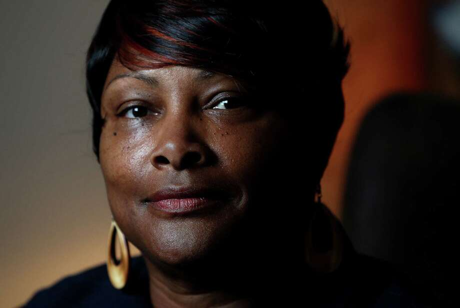 Antoinette Spencer photographed at her home, Tuesday, July 23, 2013, in Houston. Spencer was fired for trying to form a union at Bush IAH airport. She got back wages from the NLRB. SEIU is trying to organize the workers who work at Bush.  ( Karen Warren / Houston Chronicle ) Photo: Karen Warren, Staff / © 2013 Houston Chronicle