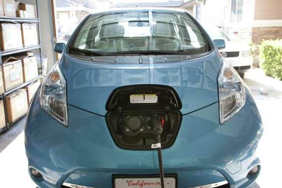 Shinya Fujimoto uses an Electric Vehicle charger for his Nissan Leaf that is installed in his Fremont, California, home on February 6, 2013. (Patrick Tehan/San Jose Mercury News/MCT)